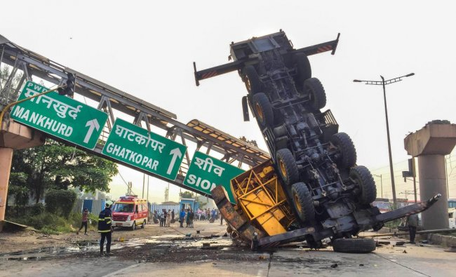 A damaged lorry after it met with an accident on Vashi Mankurdh highway, Navi Mumbai on Sunday. (PTI Photo)