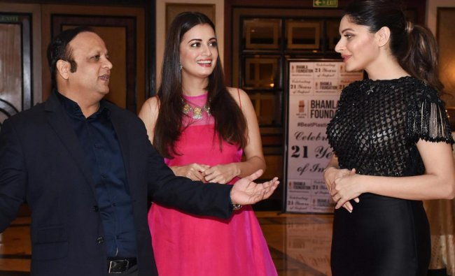 Bollywood actress Dia Mirza and singer Kanika Kapoor during the BeatPlasticPollution announcement event in Mumbai on late Wednesday. PTI Photo