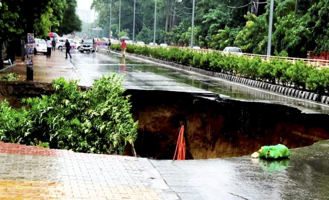Amritsar: A road caves in after continuous rains during monsoon rainfall, in Amritsar, Sunday, Sept 23, 2018. (PTI Photo)