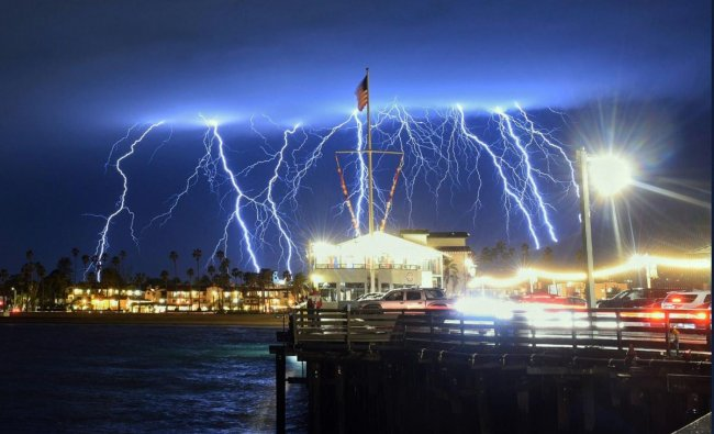 This time exposure photo provided by the Santa Barbara County Fire Department shows a series of lightning strikes over Santa Barbara, Calif., seen from Stearns Wharf in the city\'s harbor. AP/PTI