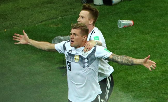 World Cup - Group F - Germany vs Sweden - Fisht Stadium, Sochi, Russia - June 23, 2018 Germany\'s Toni Kroos celebrates scoring their second goal with Marco Reus. Reuters