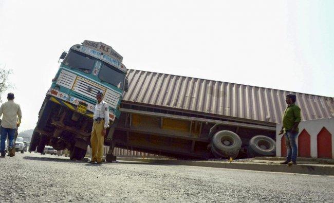 A container on its way to Mumbai from Uran JNPT struck on a flyover near NMMC Headquarters at CBD Belapur Flyover, in Navi Mumbai. PTI photo
