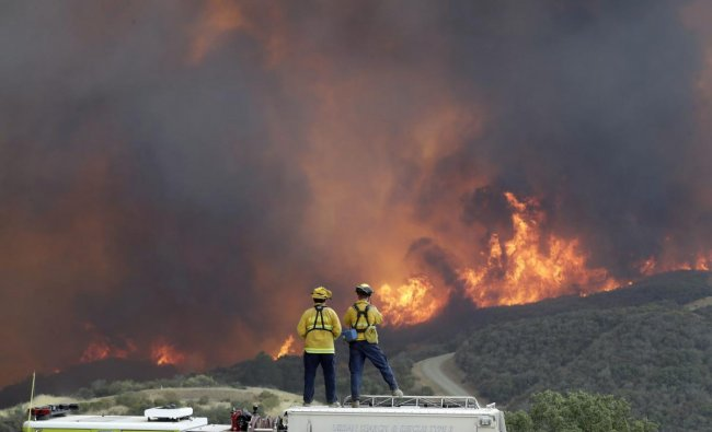 Lakeport : A fire crew from San Luis Obispo County keeps an eye on an advancing wildfire from the perimeter of a residence Tuesday, July 31, 2018, in Lakeport, Calif. Evacuation orders remained in effect Tuesday for the town of Lakeport, the county seat, along with some smaller communities and a section of the Mendocino National Forest. AP/PTI Photo