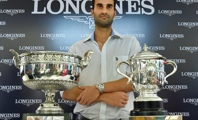 Indian tennis player Yuki Bhambri poses for a photo with Roland-Garros trophy in New Delhi on Thursday. PTI Photo