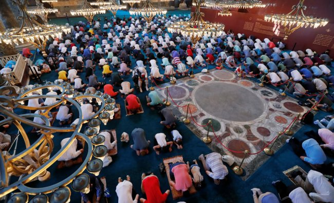 Worshippers attend the afternoon prayer at Hagia Sophia Grand Mosque in Istanbul, Turkey. Credit: Reuters Photo