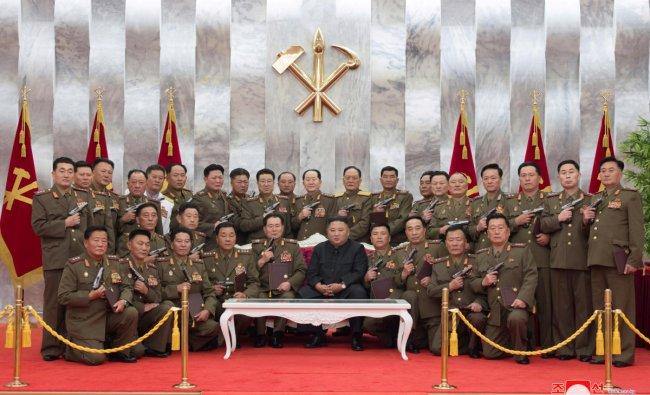 North Korean leader Kim Jong Un poses for a photograph after conferring \