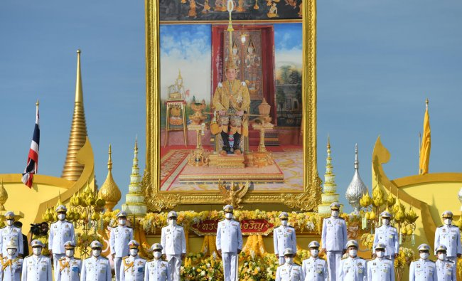 Thailand\'s Prime Minister Prayuth Chan-ocha and cabinet members pay respect to a picture of Thai King Maha Vajiralongkorn during a celebration to mark the king\'s 68th birthday in Bangkok, Thailand, July 28, 2020. Credit: Reuters Photo