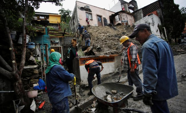 People work to remove mud and rocks after a landslide in the aftermath of Storm Hanna in Monterrey. Credit: Reuters Photo