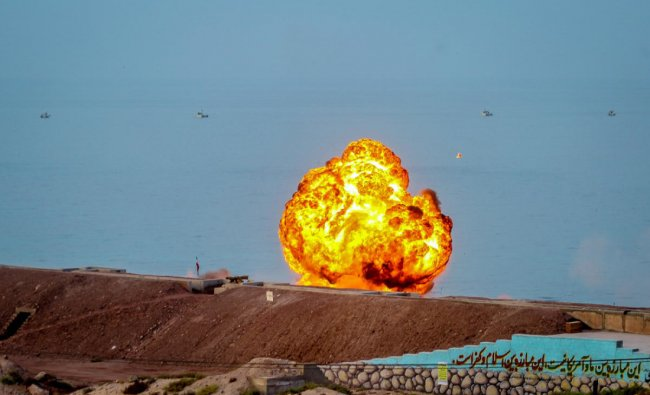 This handout photo provided by Iran\'s Revolutionary Guard Corps (IRGC) official website via SEPAH News on July 29, 2020, shows an explosion during the last day of Iranian military exercises near sensitive Gulf waters in the Strait of Hormuz. Photo by: SEPAH NEWS / AFP