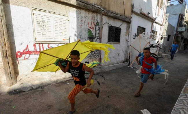 Palestinian children play in a street in the Amari refugee camp near the West Bank city of Ramallah. Credit: AFP Photo