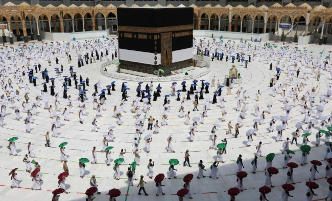 A picture taken on July 29, 2020 shows pilgrims circumambulating around the Kaaba, Islam\'s holiest shrine, at the centre of the Grand Mosque in the holy city of Mecca, at the start of the annual Muslim Hajj pilgrimage. Credit: AFP Photo