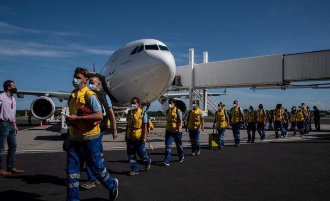 Volunteer doctors from Spain, Portugal, Argentina and Costa Rica, members of the SAMU Foundation, arrive at the Oscar Arnulfo Romero International Airport in Comalapa, El Salvador. Credit: AFP Photo