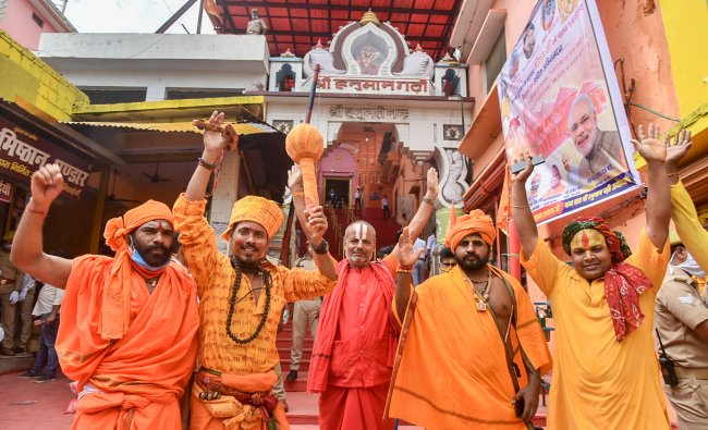 Sadhus celebrate the Bhoomi Pujan day for the construction of Ram Temple, at Hanuman Garhi