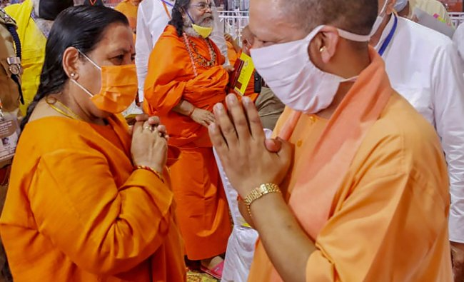 Uttar Pradesh Chief Minister Yogi Adityanath being greeted by BJP leader Uma Bharti during the function ahead of the inception of Bhoomi Pujan