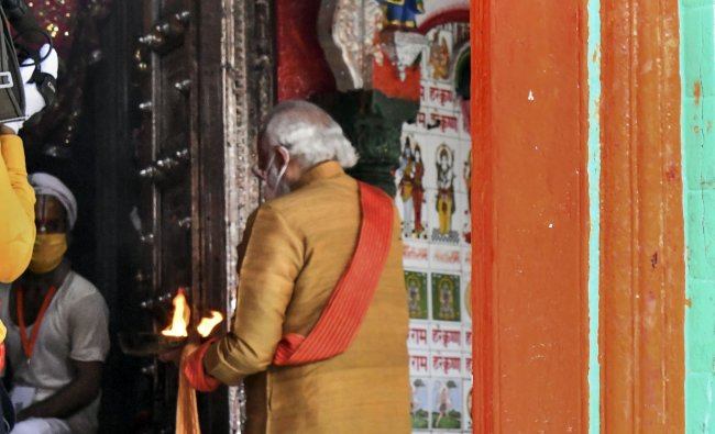 Prime Minister Narendra Modi offers prayers at the Hanumangarhi temple ahead of the foundation-stone laying ceremony of the Ram temple, in Ayodhya. Credit: PTI