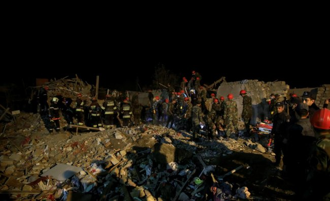 Search and rescue teams work on the blast site hit by a rocket during the fighting over the breakaway region of Nagorno-Karabakh, in the city of Ganja, Azerbaijan. Credit: Reuters Photo