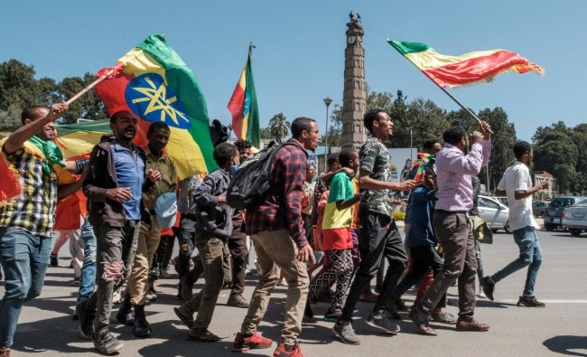 People carry Amhara flags and Ethiopian national flags in the streets after a national call to stand in honour of the Ethiopian National Defence Forces, in Addis Ababa.The United Nations on November 17, 2020 expressed alarm at the \