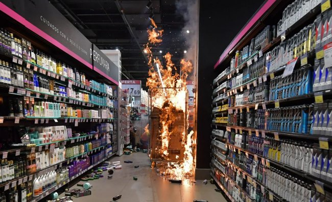 Products burn at a supermarket Carrefour in Sao Paulo, Brazil,on Black Consciousness Day after protesters invaded the place during a protest against racism and the death on the eve of a black man who was beaten by white security agents in a supermarket of the same chain in Porto Alegre and who later died. In Brazil,around 55% of the population identifies as black or mixed-race. Credit: AFP Photo