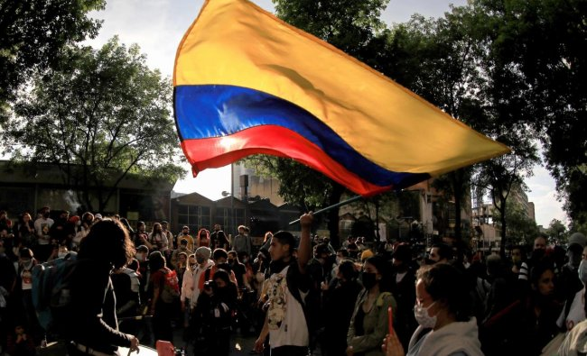 Dozens of protesters gathered on the streets of downtown Bogota to commemorate one year of the massive protests against the government of President Ivan Duque. Credit: AFP Photo