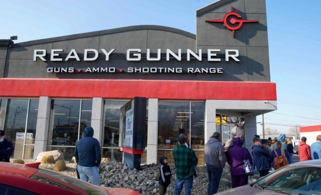 People line up to buy guns and ammunition at the Ready Gunner gun store on January 10, 2021 in Orem, Utah. - Ammunition and guns sales have spiked in Utah in the days since the storming of the Capitol building in Washington DC. Credit: AFP.