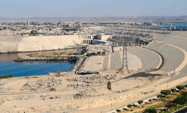 A picture taken on January 3, 2021 shows a general view of Egypt\'s High Dam in Aswan, some 920km south of the capital Cairo. - Half a century since Egypt\'s ground-breaking Aswan dam was inaugurated to fanfare, harnessing the Nile for hydropower and irrigation the giant barrier is still criticised for its human and environmental toll. Credit: AFP.