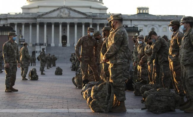 Members of the US National Guard arrive at the US Capitol on January 12, 2021 in Washington, DC. The Pentagon is deploying as many as 15,000 National Guard troops to protect President-elect Joe Biden\'s inauguration on January 20, amid fears of new violence. Credit: Tasos Katopodis/Getty Images/AFP.
