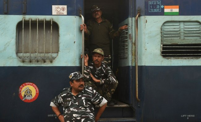 Indian paramilitary forces look on upon arriving at Chitpur Yard railway station in Kolkata ahead of the upcoming West Bengal's Legislative Assembly elections. Credit: AFP Photo