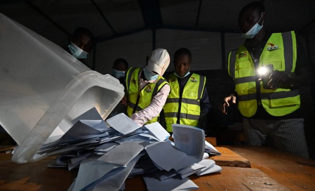 Niger's Electoral Commission workers count the ballots at a polling station during Niger's presidential election run-off in Niamey. Credit: AFP Photo