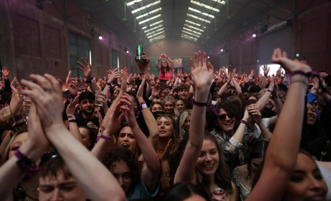People enjoy their time at a nightclub, as part of a national research programme assessing the risk of the coronavirus disease transmission, in Liverpool, Britain. Credit: Reuters Photo