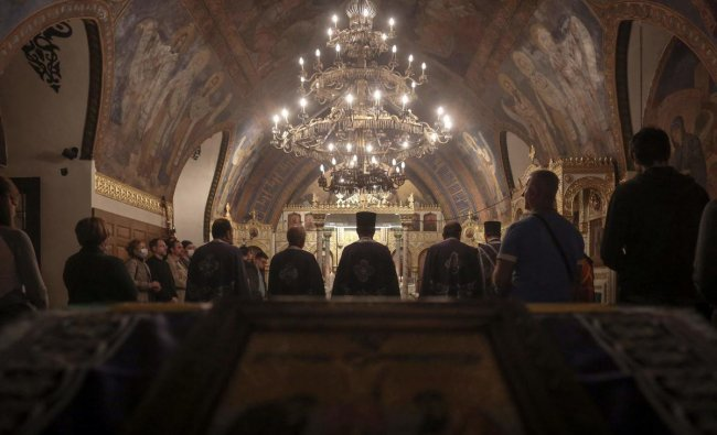 Orthodox priests lead the Good Friday service at Ruzica church in Belgrade, on April 30, 2021. Credit: AFP Photo