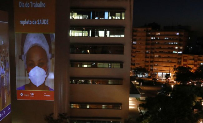 View of an image of a health professional projected on a wall of the Clinics Hospital in Porto Alegre, Brazil, on April 30, 2021, on the even of the International Workers\' Day to show gratitude for health workers\' commitment to life amid the Covid-19 pandemic. Credit: AFP Photo
