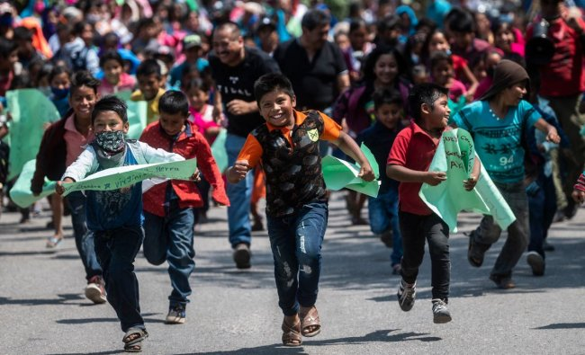 Children take part in a demo for justice and the end of violence in the framework of the celebration of Children\'s Day in Alcozacan, Guerrero state, Mexico. Credit: AFP Photo
