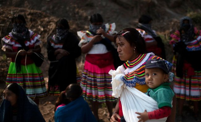A woman in traditional attire and her toddler attend a demo for justice and the end of violence in the framework of the celebration of Children\'s Day in Alcozacan, Guerrero state, Mexico. Credit: AFP Photo