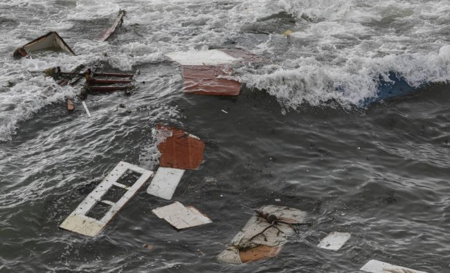 Suspected human smuggling boat capsizes off San Diego coast leaving at least 3 dead. Debris is littered along the shoreline off Cabrillo Monument on May 2, 2021 in San Diego, California. Credit: AFP