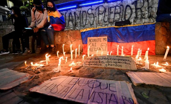 Demostrators make a vigil for fellow demonstrators who died, disappeared or were wounded in the past days\' protests against a tax reform bill launched by President Ivan Duque in Cali, Colombia, on May 2, 2021. Credit: AFP Photo