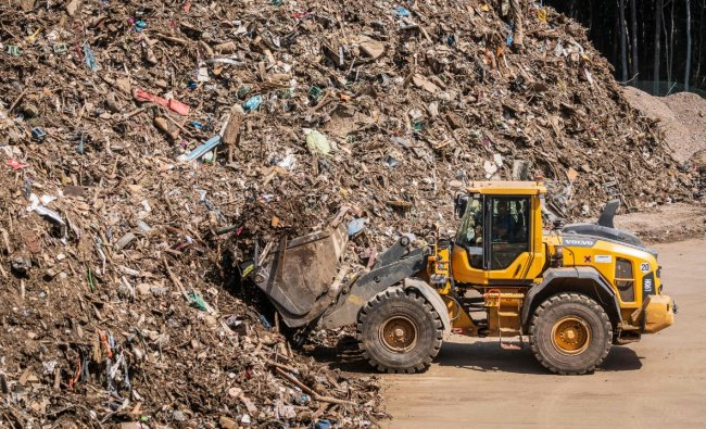 Over 30,000 tons of waste have already been delivered at the waste management center since clearing works begun, days after heavy rain and floods caused major damage in the Ahr region. Credit: AFP Photo