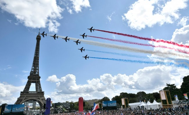 French aerial patrol \'Patrouille de France\' fly over the fan village of The Trocadero set in front of The Eiffel Tower, in Paris. Credit: AFP Photo