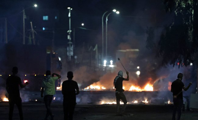 Palestinian protesters gather during a demonstration against the Israeli settlers\' outpost of Eviatar, in the town of Beita, near the occupied West Bank city of Nablus. Credit: AFP Photo