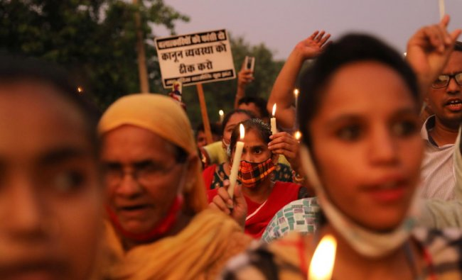 People attend a candlelight vigil to protest against the alleged rape and murder of a 9-year-old girl in New Delhi. Credit: Reuters Photo