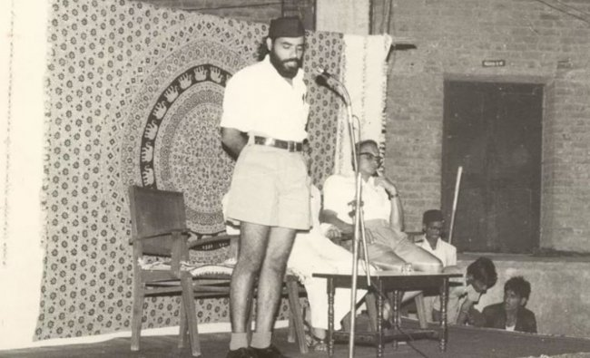 Modi joined the Rashtriya Swayamsevak Sangh (RSS) organisation in the early 1970s. He gained prominence and rose steadily in the RSS hierarchy over the years. In this photo, Narendra Modi is seen addressing the RSS swayamsevaks at an event. Credit: NaMo App