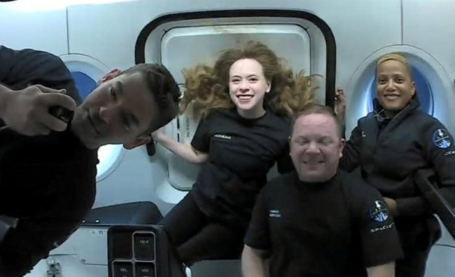 Inspiration4 crew Jared Isaacman, Sian Proctor, Hayley Arceneaux, and Chris Sembroski chatting with St. Jude patients from space. Credit: SpaceX/Handout via Reuters