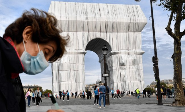 """Roselyne Bachelot, the culture minister, said: """"The Arc de Triomphe is taken away from our gaze and at the same time overexposed to our gaze. This subtraction and this overexposure lie at the core of the work. Thank you, Christo, for offering us the gift of looking in another way, in a new way, at masterpieces built by other artists."""" Credit: AFP Photo"""