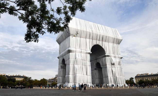 The Arc de Triomphe, like any great monument, was built to last. Christo's conceptual art is ephemeral. Within weeks it will be dismantled. There is something liberating in this, perhaps because the fleeting nature of the work makes possession impossible. The work is immense, yet insubstantial. The fabric seems to express something nomadic, in keeping with Christo's own peripatetic life. Credit: AFP Photo