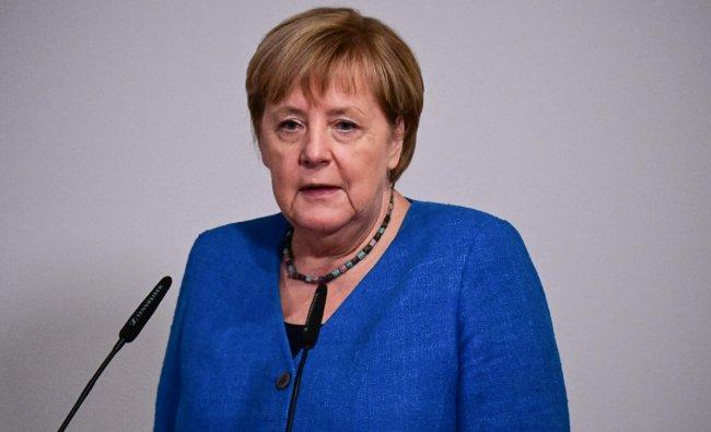 Merkel in photos: From football fan to Trump tamer