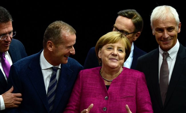 If football saw the feel-good side of Merkel, the Greeks bore the brunt of a harder line. Unmoved by the pleas of Greece during the eurozone debt crisis, Merkel stuck to Germany\'s mantra demanding that Athens carry out austerity reforms in exchange for bailout loans. As Greece stood at the brink of an economic collapse that threatened to force it out of the eurozone in 2015, Greeks went on the march, with some bearing posters portraying Merkel with a Hitler moustache. Credit: AFP Photo
