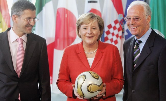 In 2005, her conservative CDU-CSU alliance narrowly won the election and Merkel was sworn in as Germany\'s first female chancellor in November. Barely a year in office, Germany\'s new chancellor would play host to the world\'s most-watched game -- at the 2006 football World Cup. Credit: Getty Images