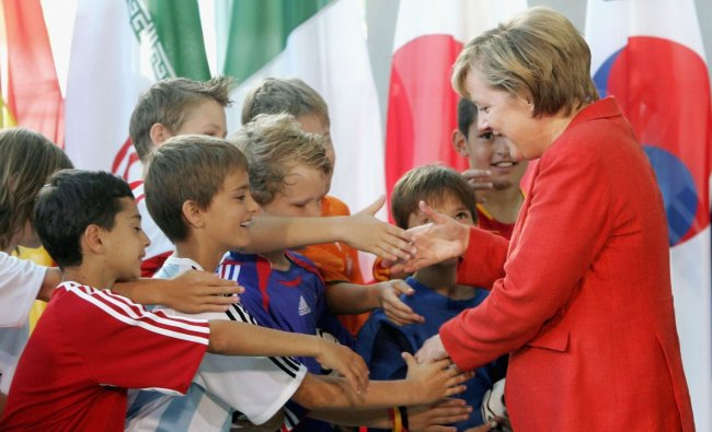 The home team finished third, but after Germans dared to wave their flags joyously again, Time magazine branded Merkel \