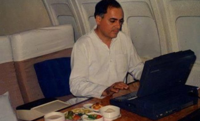 A picture of PM Rajiv Gandhi working while in a flight. Credit: Twitter/@NotAfangirll_