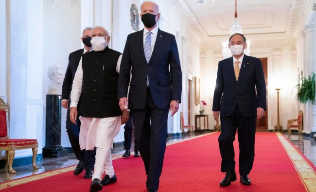 PM Modi walks to the Quad summit with US President Jo Biden, Australian Prime Minister Scott Morrison and Japanese Prime Minister Yoshihide Suga to the East Room of the White House. Credit: AP Photo