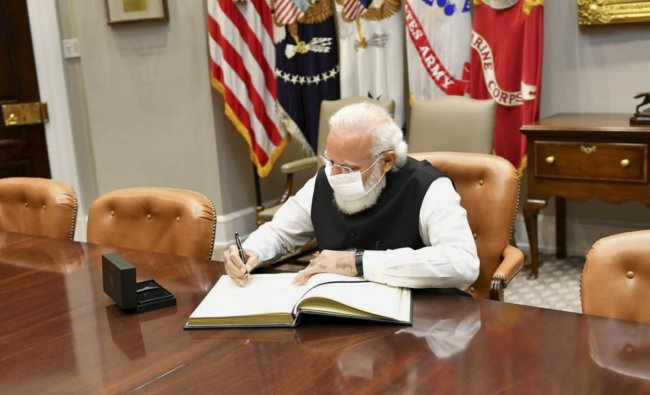 Registering the spirit of US-India friendship in ink, Modi signed the visitors\' book in the Roosevelt Room here at the White House. Credit: PTI Photo